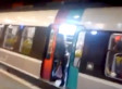 Woman Holding Up Train Is Literally Kicked Off (VIDEO)