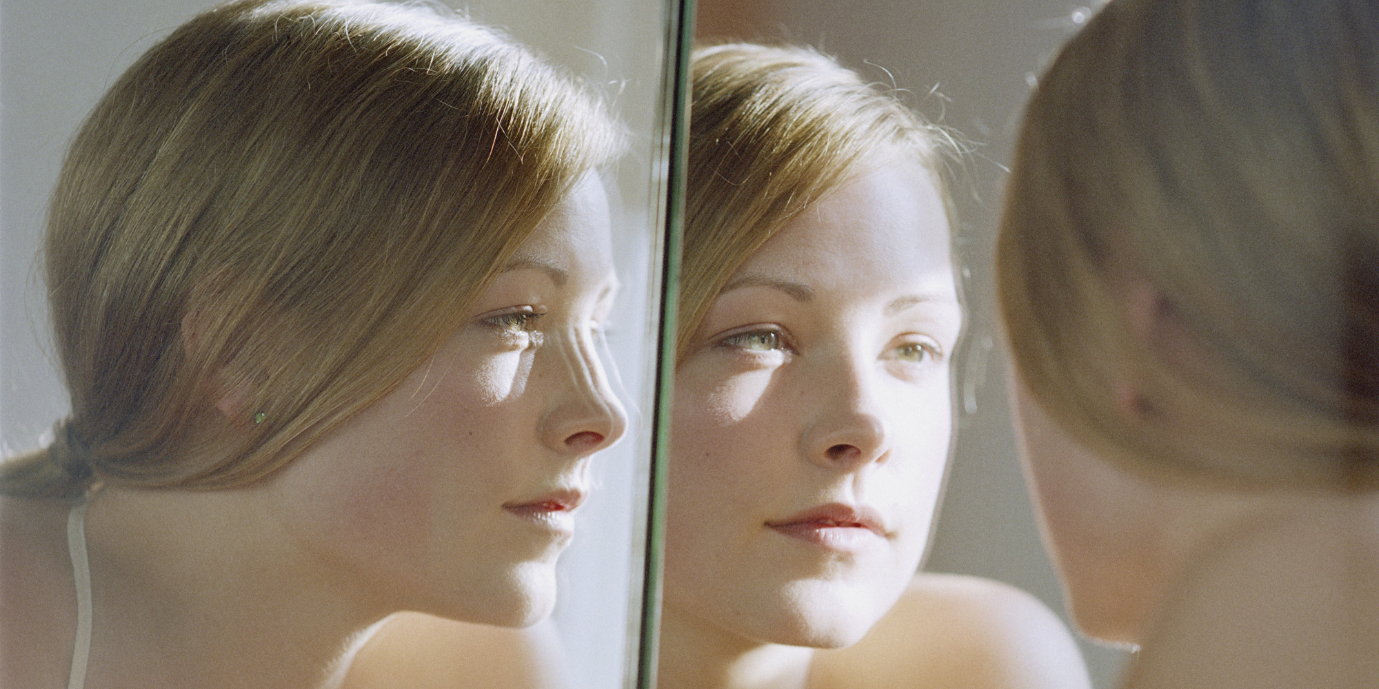 insecure person looking in mirror. insecure person looking in mirror girl l