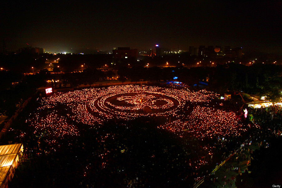 thousands of indian hindu devotees light candles