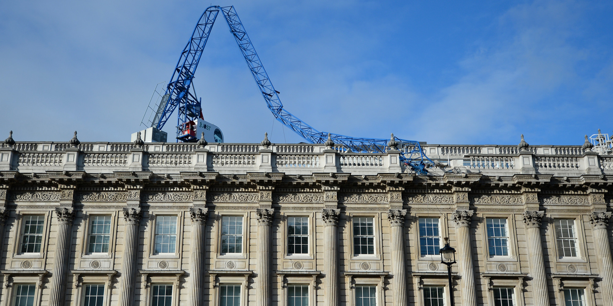 uk storm: crane collapses on cabinet office roof, nick clegg