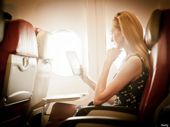 person reading on a plane