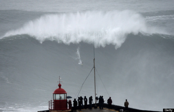 Biggest wave ever surfed carlos burle rides 100 foot wave off coast