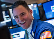 Dow Closes At Record High On Fed Stimulus Hopes