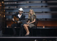 'Obamacare By Morning': CMAs Hosts Carrie Underwood, Brad Paisley Lampoon Healthcare Woes