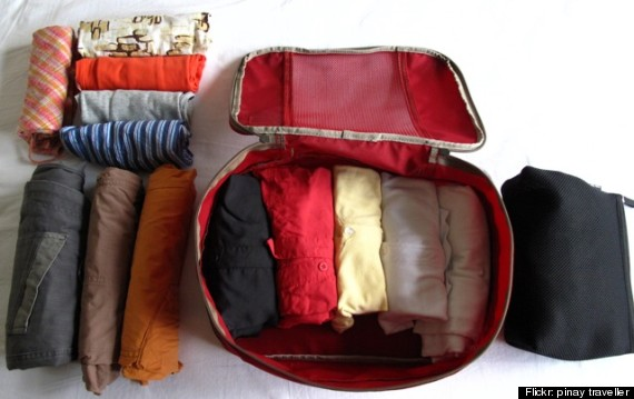 rolled clothes suitcase