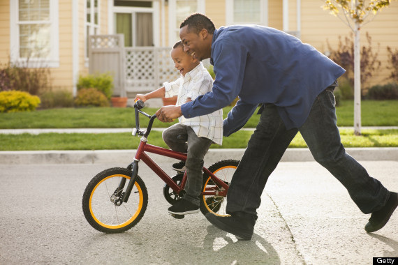 kid riding bike without training wheels
