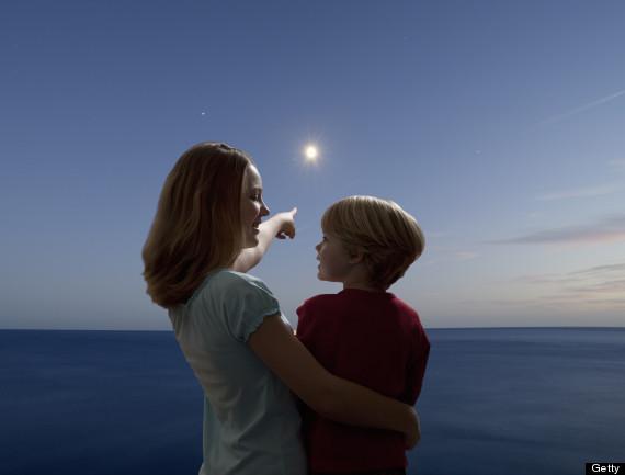 kid looking at moon