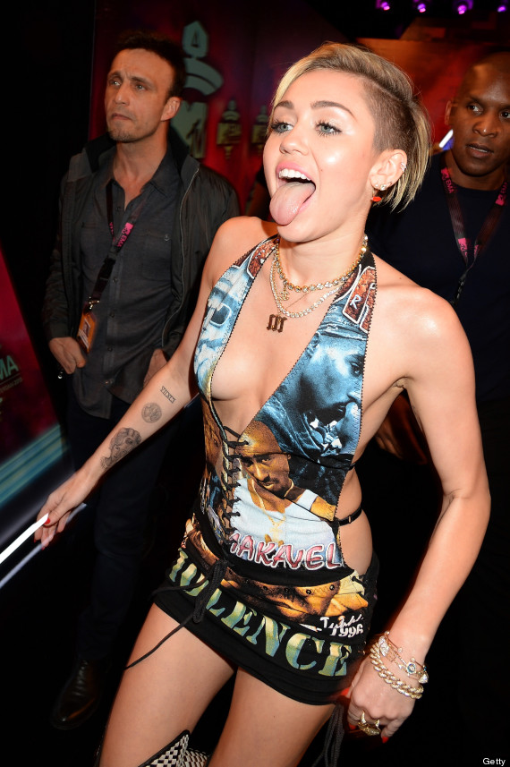 Miley Cyrus Turns Heads At The MTV EMAs In Plunging, Backless Dress