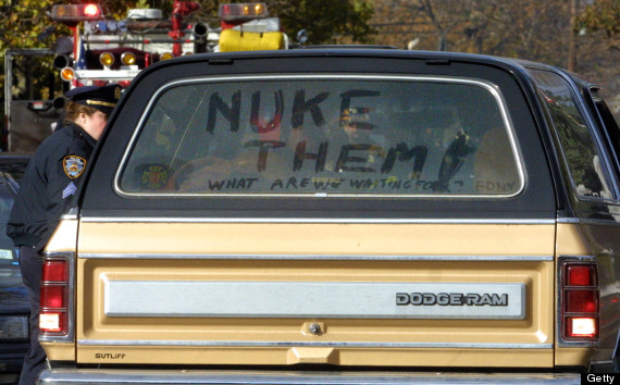 A truck driven near the crash site is decorated with the words 'Nuke Them'  after American Airlines flight 587, carrying 255 people, crashed minutes  after ...