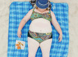 We Can't Look Away From These Awkward Portraits Of People Sleeping On The Beach