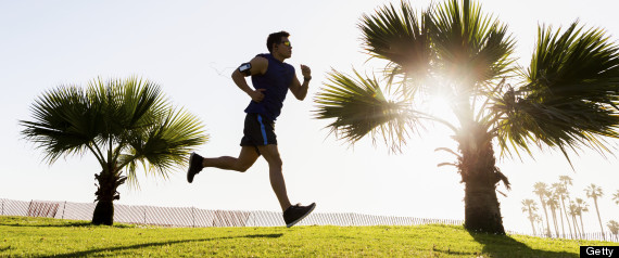 man running outside grass