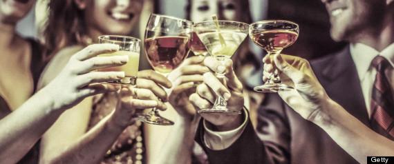hands toast drinks bar
