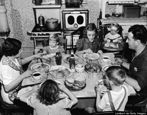 1950s family around dinner table