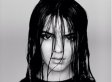 Kendall Jenner Poses In Risque Fishnet Shirt