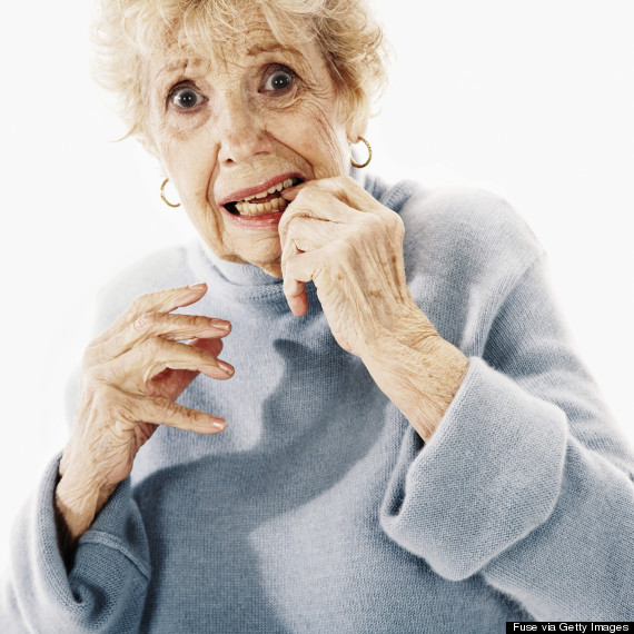 older person biting their nails