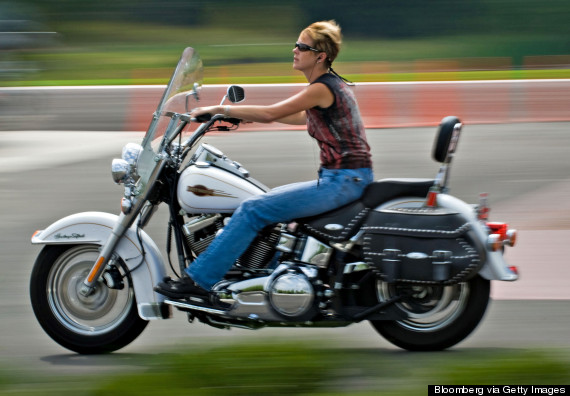 woman riding a harley davidson