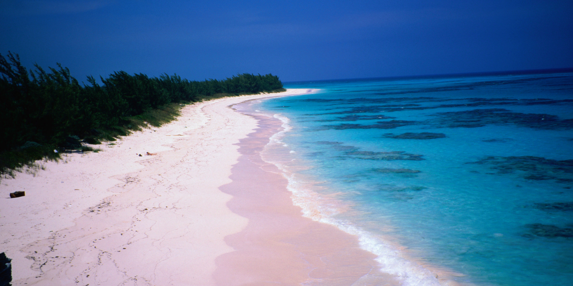 Most colorful beaches in the world huffpost for Bahamas pink sand beaches