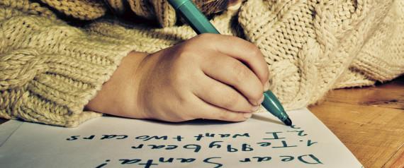 CHILD WRITING CHRISTMAS LIST