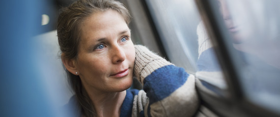 OLDER WOMAN LOOKING AT PHOTOGRAPH