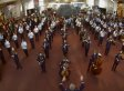 U.S. Air Force Band Surprises Museum Goers With A Holiday Music Flash Mob