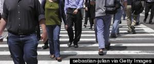 MAN WALKING IN TIMES SQUARE