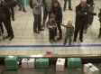 WestJet Finds Out What Passengers Want For Christmas, Leaves Presents At Baggage Claim (VIDEO)
