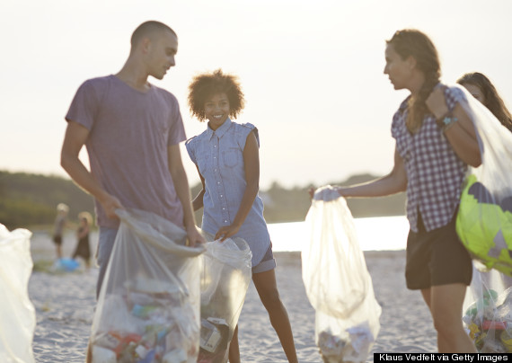 picking up trash on the beach