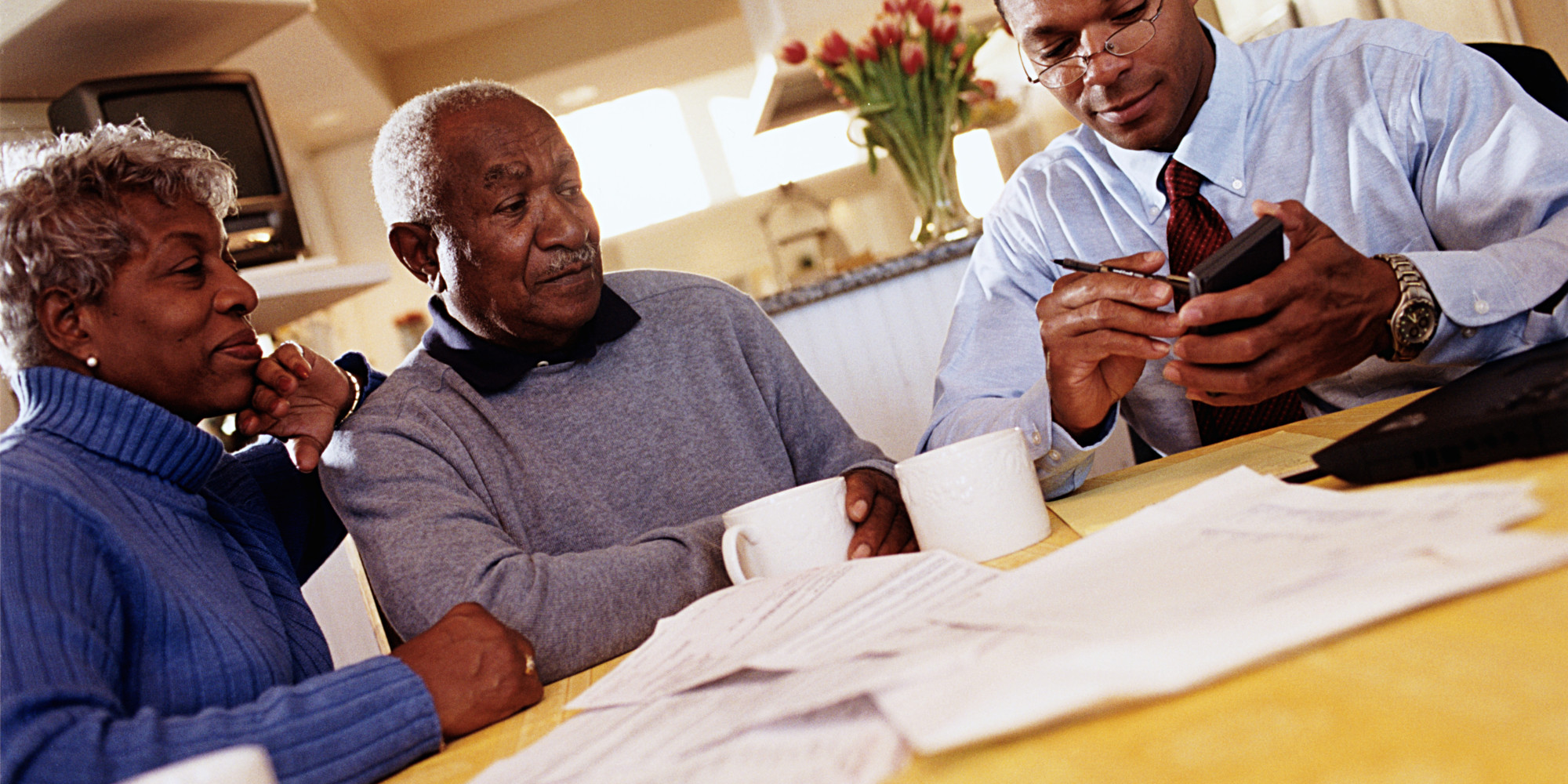 o-AFRICAN-AMERICAN-COUPLE-WITH-FINANCIAL-PLANNER-facebook.jpg