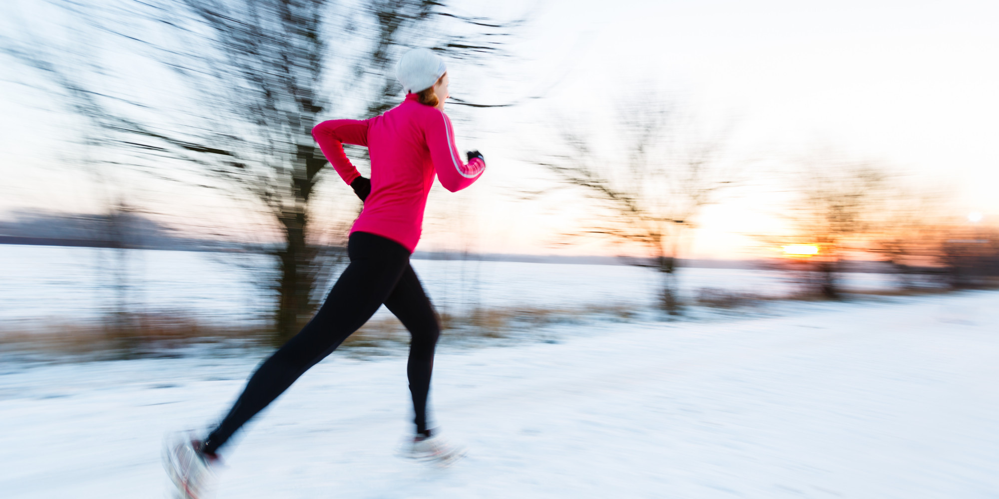 Winter Fitness Challenge -- woman running in the snow