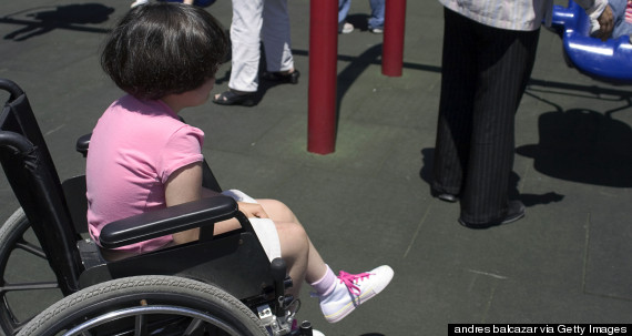 person in wheelchair sad