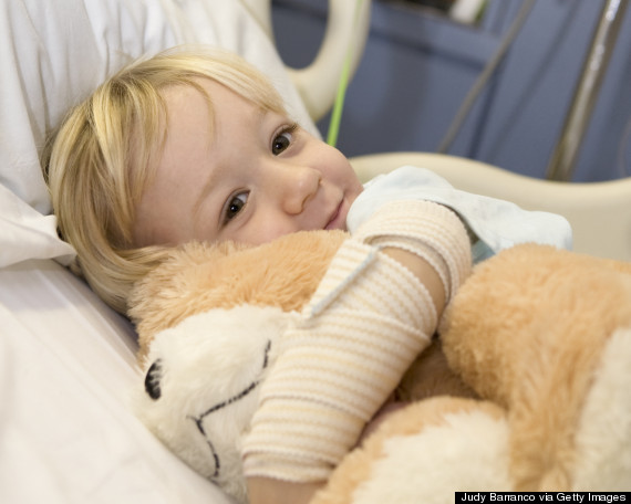 sick child in hospital smiling