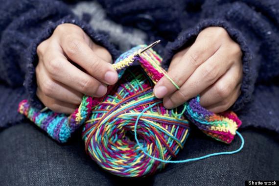 hands knitting blanket