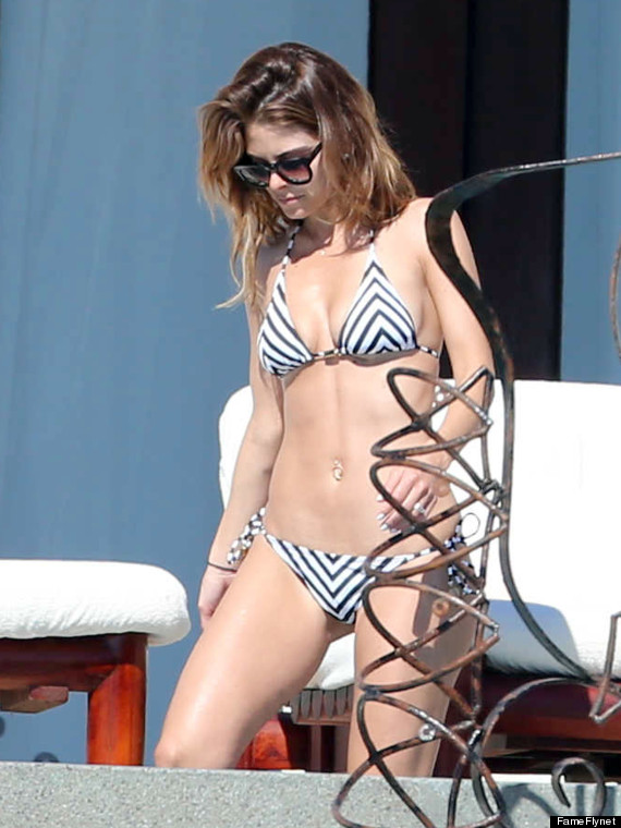 Maria Menounos relaxes in a White Bikini as she soaks up the sun in Mexico