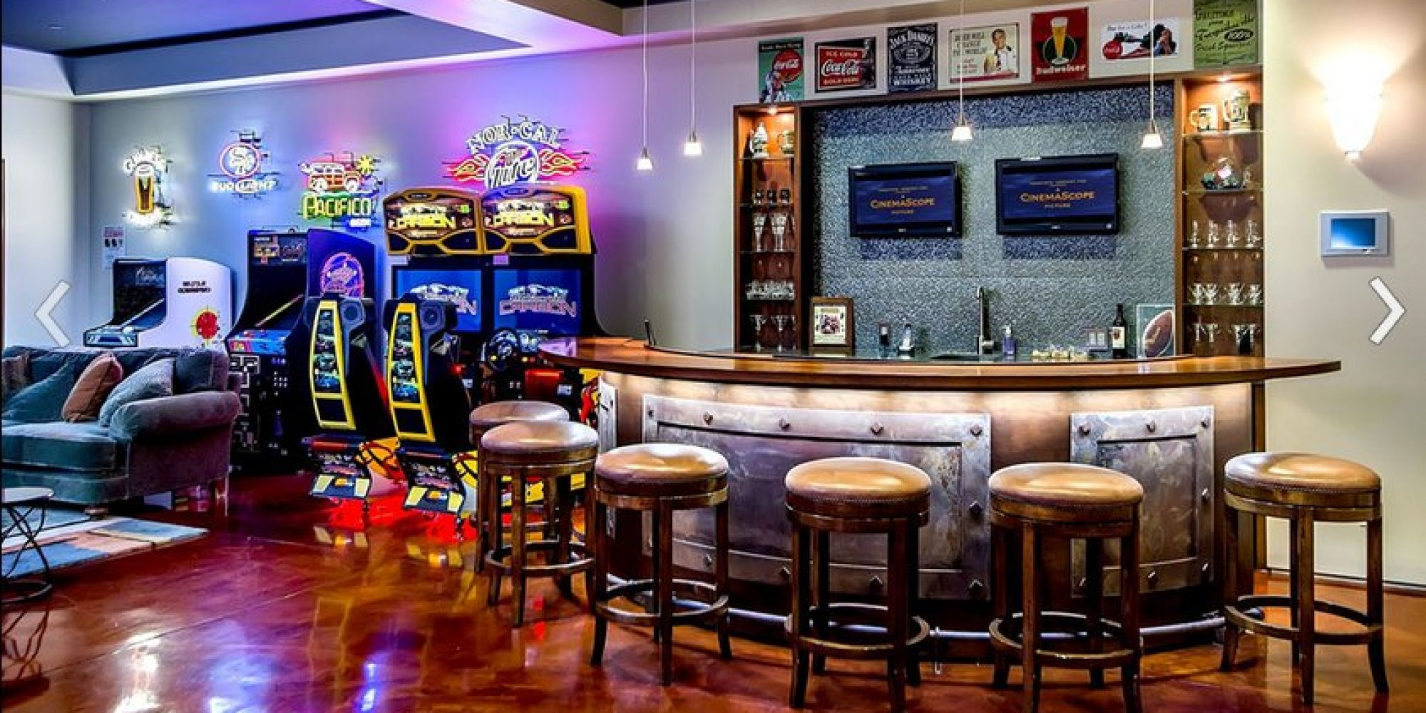 Awesome arcade room with full bar is the room you 39 d never Basement game room ideas