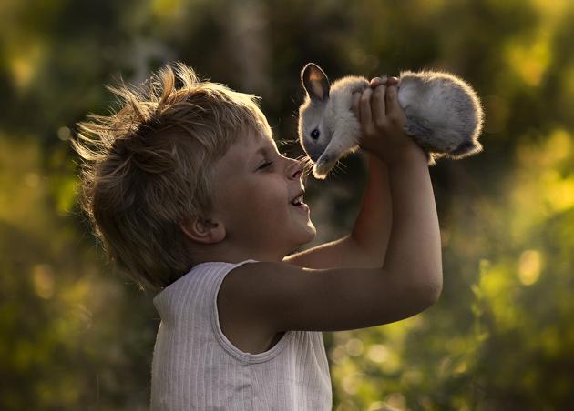 older boy with rabbit