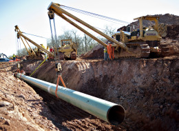 A 60-foot section of pipe is lowered into a trench during construction of the Gulf Coast Project pipeline in Prague, Okla. on Monday, March 11, 2013. (Credit: Daniel Acker/Bloomberg via Getty Images) Click to enlarge.