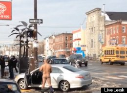 Why Is This Naked Man Playing With Himself Near His Crashed Car?