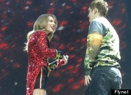 PICS: Taylor's London Show Interrupted By Stage-Invading Fan