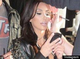 Kim Kardashian Shares Risque Braless Throwback