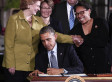 Obama Signs Farm Bill That Trims Food Stamps