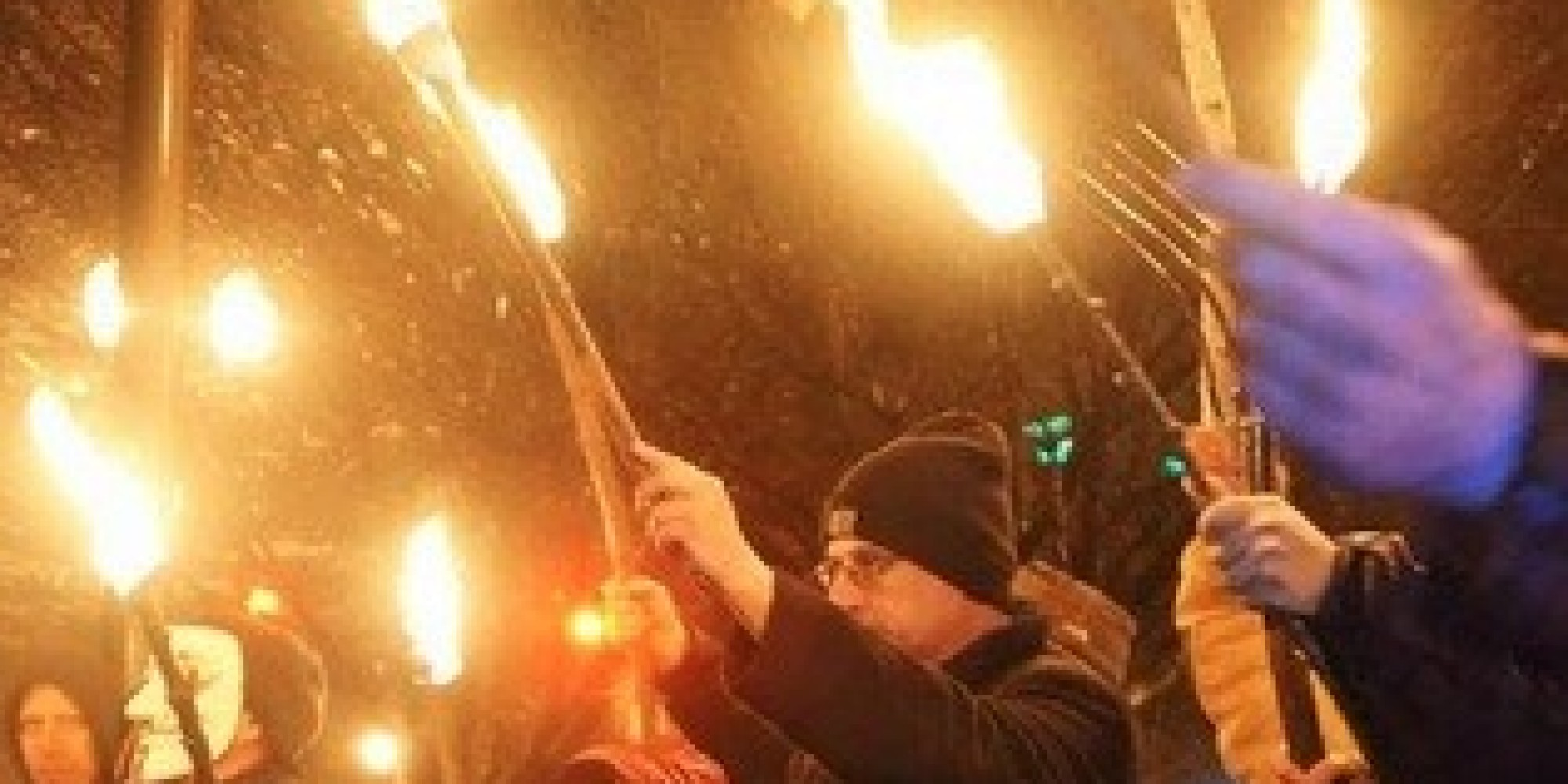 angry residents wave pitchforks  torches in protest of