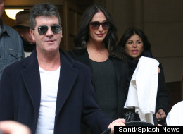 Simon Cowell Grins With Pride