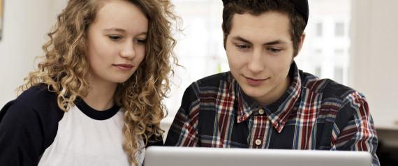 TEENS LOOKING AT COMPUTER