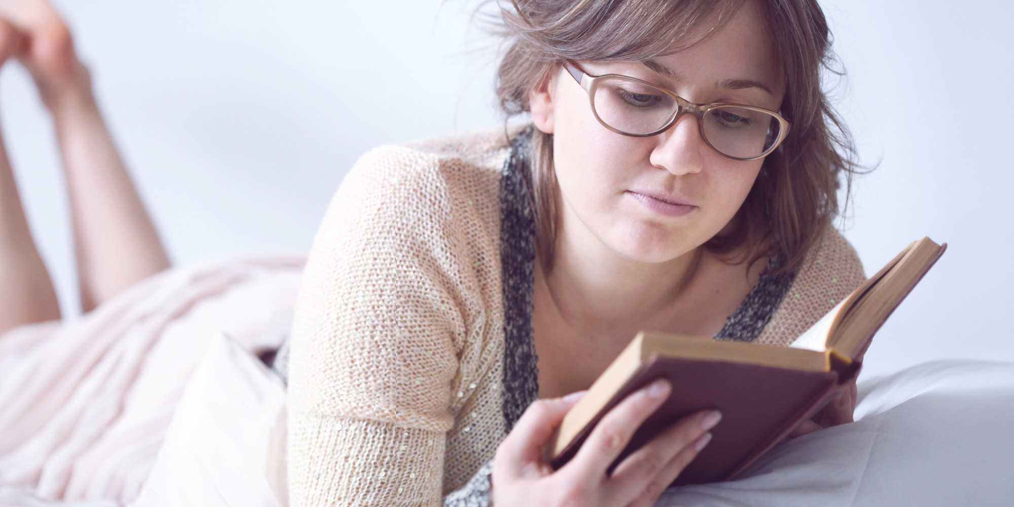 Woman reading a book at a bar