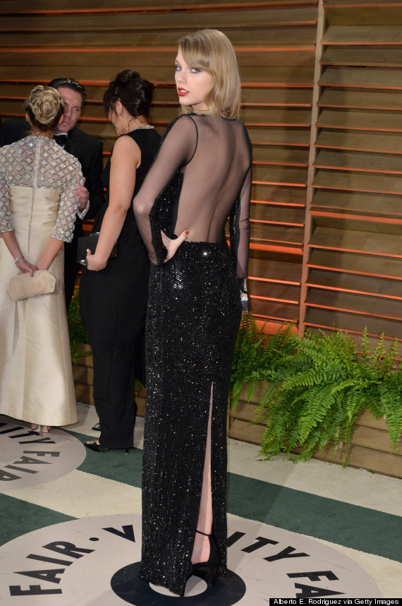 Taylor Swift Slips Into Slinky Black Gown For Vanity Fair Oscars ...