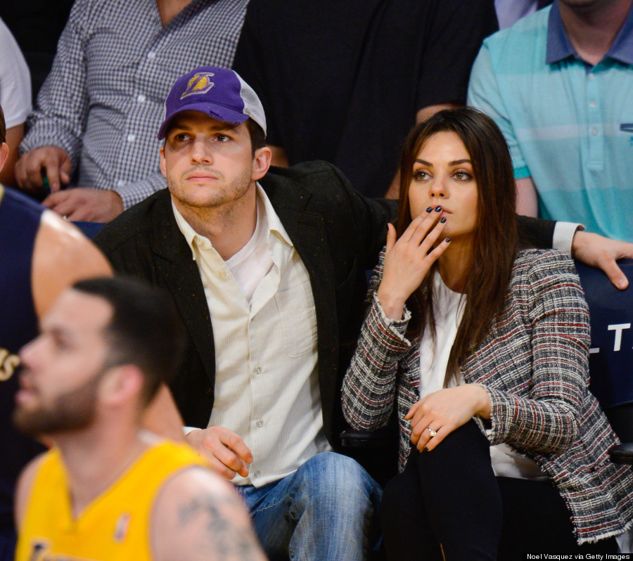 mila kunis shows off engagement ring with ashton kutcher