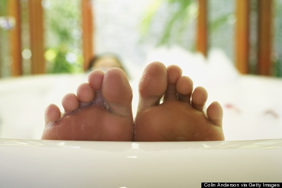 woman toe bathtub