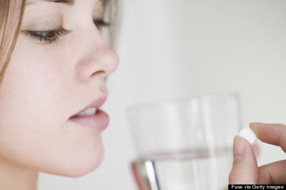 woman pill water