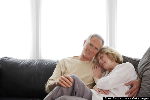 older couple cuddling on sofa