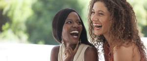 Two Black Women Laughing Together
